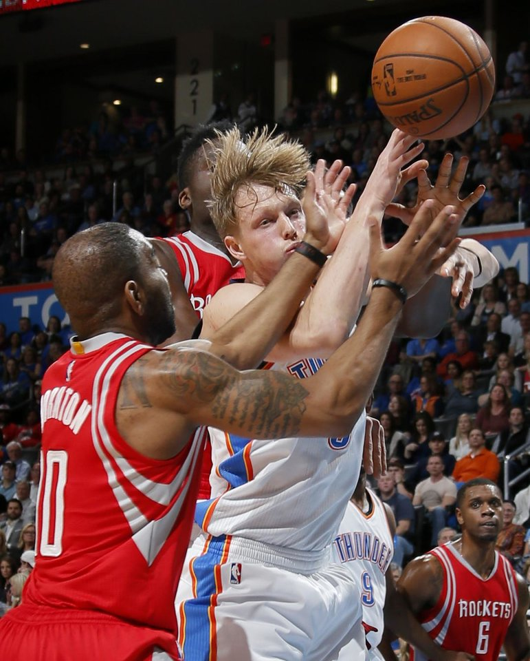 Photo - Oklahoma City's Kyle Singler (5) fight for a rebound with Houston's Marcus Thornton (10) during an NBA basketball game between the Oklahoma City Thunder and the Houston Rockets at Chesapeake Energy Arena in Oklahoma City, Friday, Jan. 29, 2016. Oklahoma City won 116-108. Photo by Bryan Terry, The Oklahoman