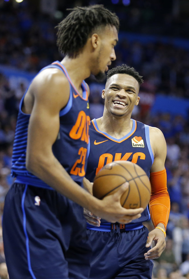 Photo - Oklahoma City's Russell Westbrook (0) laughs with Terrance Ferguson (23) during the NBA basketball game between the Oklahoma City Thunder and Houston Rockets at the Chesapeake Energy Arena, Tuesday, April 9, 2019. Cowboys won 6-5. Photo by Sarah Phipps, The Oklahoman
