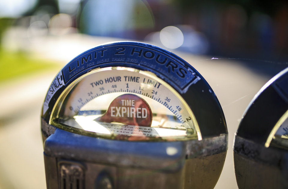 Photo -  An expired parking meter in downtown Oklahoma City. [Photo by Chris Landsberger, The Oklahoman]