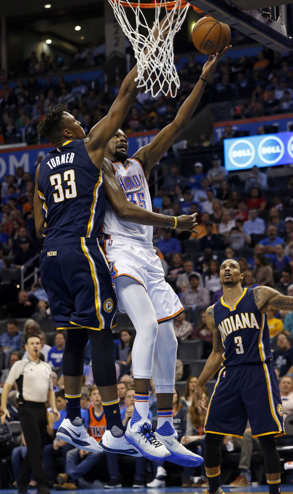 Photo - Oklahoma City Thunder's Kevin Durant (35) scores guarded by Indiana's Myles Turner (33) in the second half of an NBA basketball game where the Oklahoma City Thunder lost to the Indiana Pacers 101-98 at the Chesapeake Energy Arena in Oklahoma City, on Feb. 19, 2016.  Photo by Steve Sisney The Oklahoman