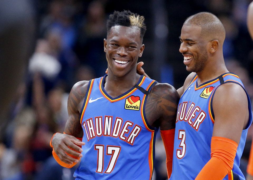Photo - Oklahoma City's Dennis Schroder (17) and Chris Paul (3) celebrates during the NBA basketball game between the Oklahoma City Thunder and the Portland Trail Blazers at the Chesapeake Energy Arena in Oklahoma City, Saturday, Jan. 18, 2020.  [Sarah Phipps/The Oklahoman]