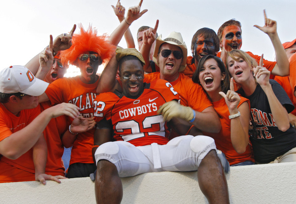 Photo - Oklahoma State's Dantrell Savage celebrates with the Cowboy fans after the 49-45 win over Texas Tech in  the college football game between the Oklahoma State University Cowboys (OSU) and the Texas Tech University Red Raiders (TTU) at Boone Pickens Stadium  on Saturday, Sept. 22, 2007, in Stillwater, Okla. 