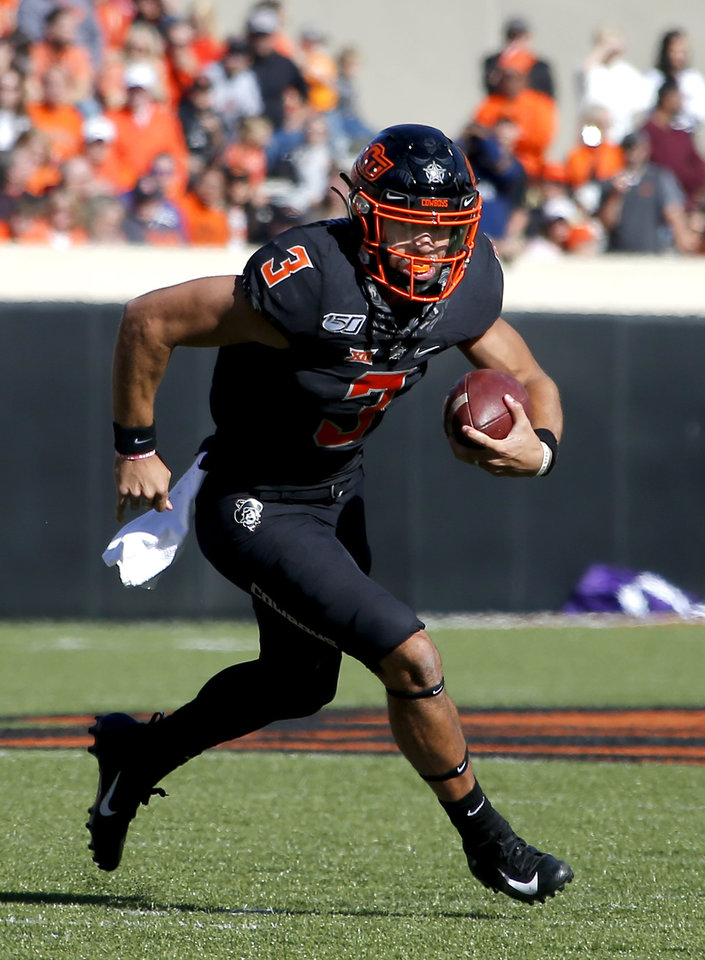 Photo - Oklahoma State's Spencer Sanders (3) rushes during the college football game between the Oklahoma State University Cowboys and the TCU Horned Frogs at Boone Pickens Stadium in Stillwater, Okla.,  Saturday, Nov. 2, 2019. OSU won 34-27. [Sarah Phipps/The Oklahoman]