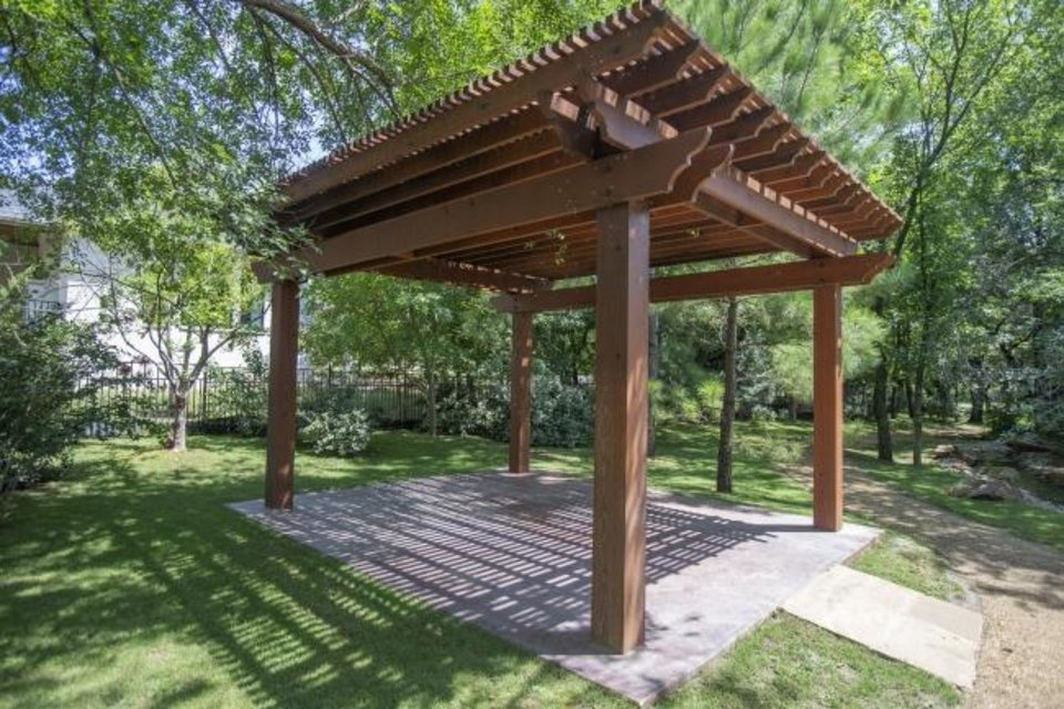 Photo -  Pergola in the park at Stonemill Manor, a small enclave next to the larger Stonemill neighborhood by developer David Yost a quarter-mile west of Coltrane Road on the south side of NE 122. [BRYAN TERRY/THE OKLAHOMAN]
