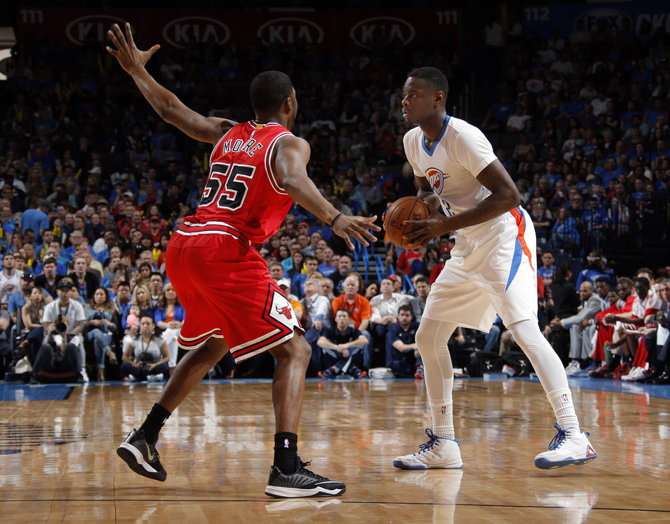 Photo - Oklahoma City's Anthony Morrow (2) looks to pass the ball around Chicago's E'Twaun Moore during the NBA game between the Oklahoma City Thunder and the Chicago Bulls at Chesapeake Energy Arena in Oklahoma City, Sunday, March  15, 2015. Photo by Sarah Phipps, The Oklahoman