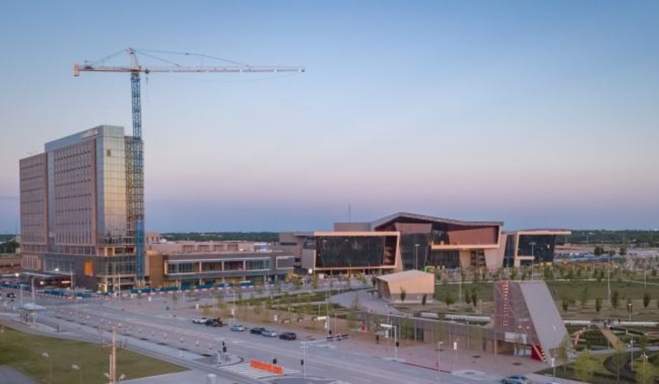 Photo -  The Omni Hotel and Oklahoma City Convention Center, across from Scissortail Park, is shown in this recent photo. [PHOTO BY DAVE MORRIS/THE OKLAHOMAN]