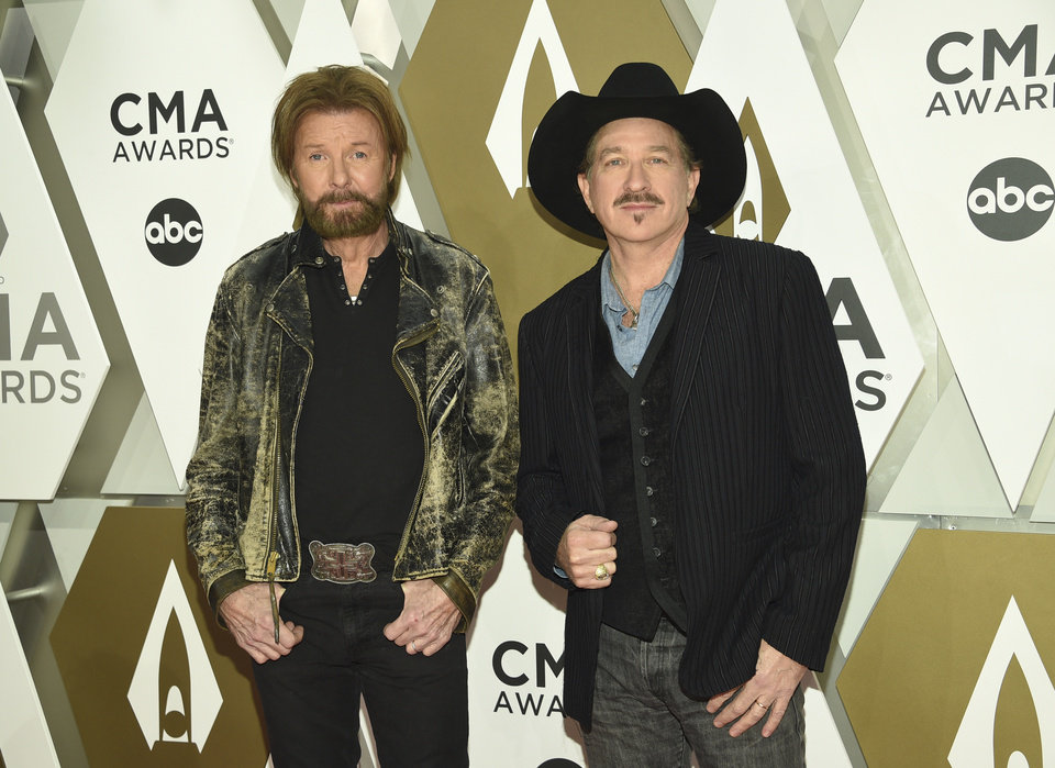 Photo - Ronnie Dunn, left, and Kix Brooks of Brooks & Dunn arrive at the 53rd annual CMA Awards at Bridgestone Arena on Wednesday, Nov. 13, 2019, in Nashville, Tenn. (Photo by Evan Agostini/Invision/AP)
