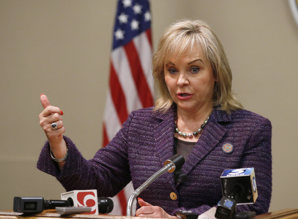"Photo - Oklahoma Gov. Mary Fallin speaks during a news conference in Oklahoma City, Thursday, Oct. 8, 2015. Fallin said ""it became apparent"" during discussions with prison officials last week that the Department of Corrections used potassium acetate, not potassium chloride, as required under the state's protocol, to execute Charles Frederick Warner in January. ""Until we have complete confidence in the system, we will delay any further executions,"" Fallin said. (AP Photo/Sue Ogrocki)"
