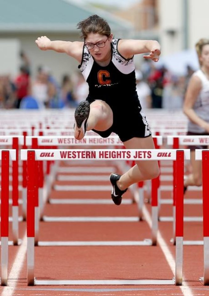 Photo -  Carney's Haley Newlun competes in the Class A girls 100-meter hurdles during the Class A and 2A state track meet Saturday at Western Heights High School. [Sarah Phipps/The Oklahoman]