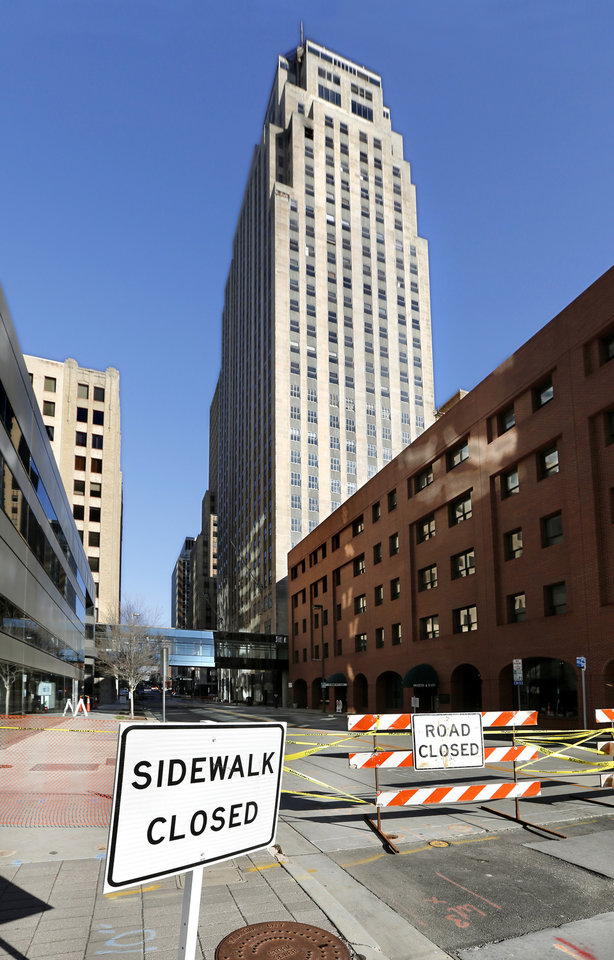 Photo - A block of N. Robinson Ave.  in downtown Oklahoma City is closed to vehicles and pedestrians Monday morning, Jan. 8, 2018, after large chunks of masonry fell from the 26th floor of the First National Center Sunday night. Fire crews were called out to the area near Robinson and Main Street shortly after 9 p.m. and discovered the chunks of concrete on the sidewalk on Robinson. The First National Center is currently undergoing extensive renovation. Friday, Jan. 5, 2018 Photo by Jim Beckel, The Oklahoman