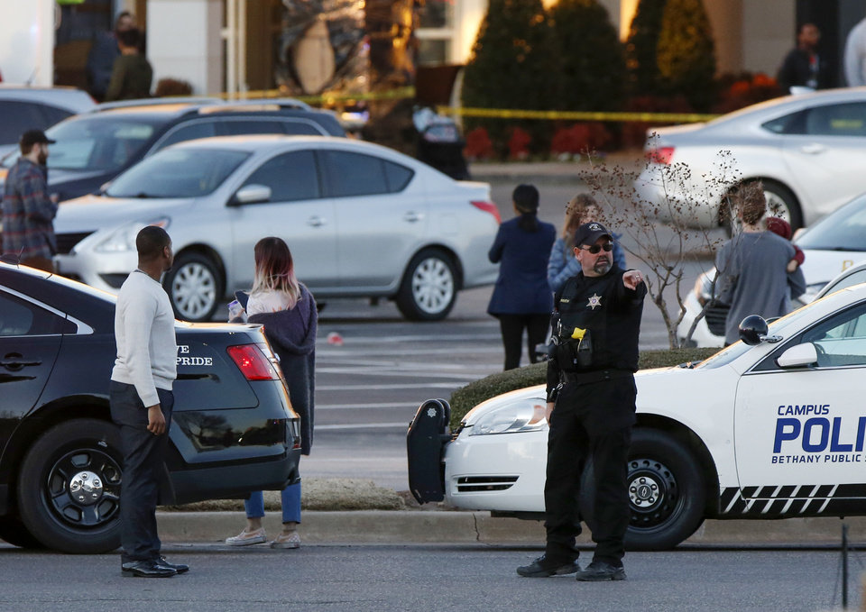 Photo - Law enforcement works the scene after a shooting at Penn Square Mall in Oklahoma City, Thursday, Dec. 19, 2019. [Nate Billings/The Oklahoman]