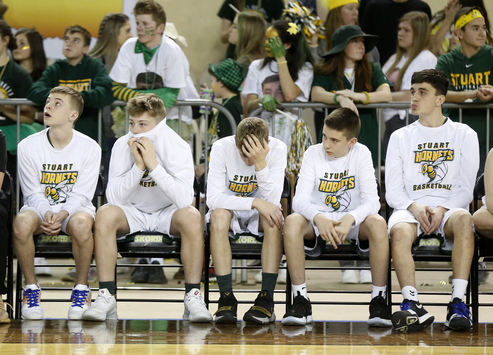 "Photo - Stuart players sit on the bench in the fourth quarter during a Class A boys high school basketball semifinal game in the state tournament against Arapaho-Butler inside Jim Norick Arena, ""The Big House,"" at State Fair Park in Oklahoma City, Friday, March 6, 2020. Arapaho-Butler won 65-56. [Nate Billings/The Oklahoman]"