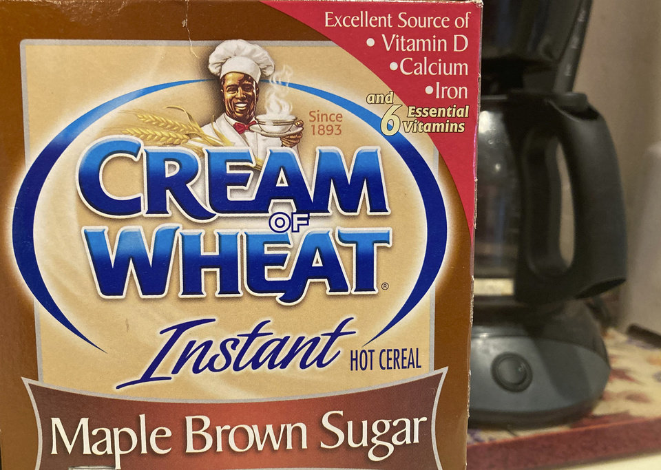 "Photo -  A box of Cream of Wheat is displayed on a counter, Thursday, June 18, 2020 in White Plains, N.Y.  Cream of Wheat and Mrs. Butterworth are the latest brands reckoning with racially charged logos. B&G Foods Inc., which makes Cream of Wheat hot cereal, said it is initiating ""an immediate review"" of its packaging. A smiling black chef holding a bowl of cereal has appeared on Cream of Wheat packaging and in ads since at least 1918, according to the company's web site. (AP Photo/Donald King)"
