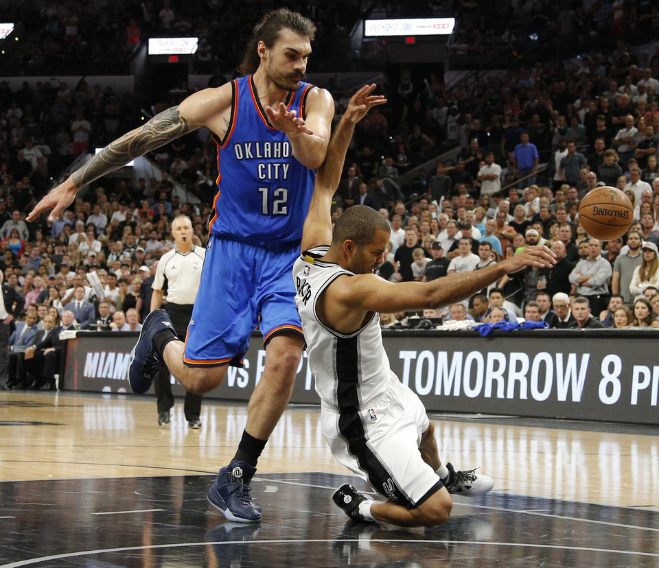 Photo - Oklahoma City's Steven Adams (12) fouls San Antonio's Tony Parker (9) during Game 5 of the second-round series between the Oklahoma City Thunder and the San Antonio Spurs in the NBA playoffs at the AT&T Center in San Antonio, Tuesday, May 10, 2016. Oklahoma City won 95-91. Photo by Bryan Terry, The Oklahoman