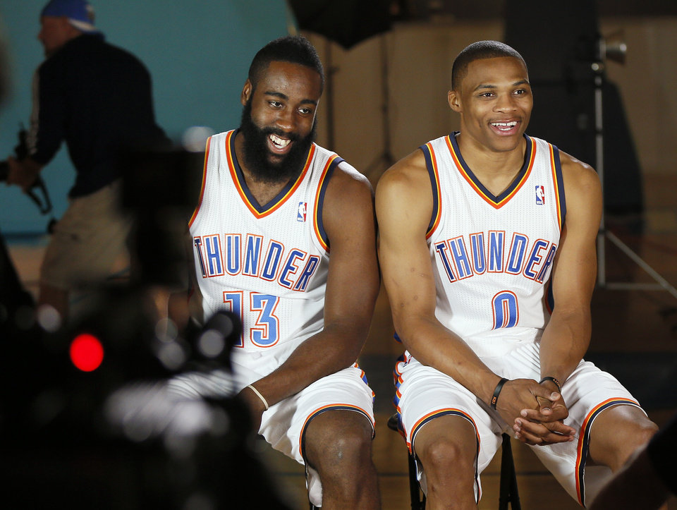 Photo - James Harden, left, and Russell Westbrook give a television interview during media day for the Oklahoma City Thunder NBA basketball team at the Thunder Events Center in Oklahoma City, Monday, Oct. 1, 2012.  Photo by Nate Billings, The Oklahoman