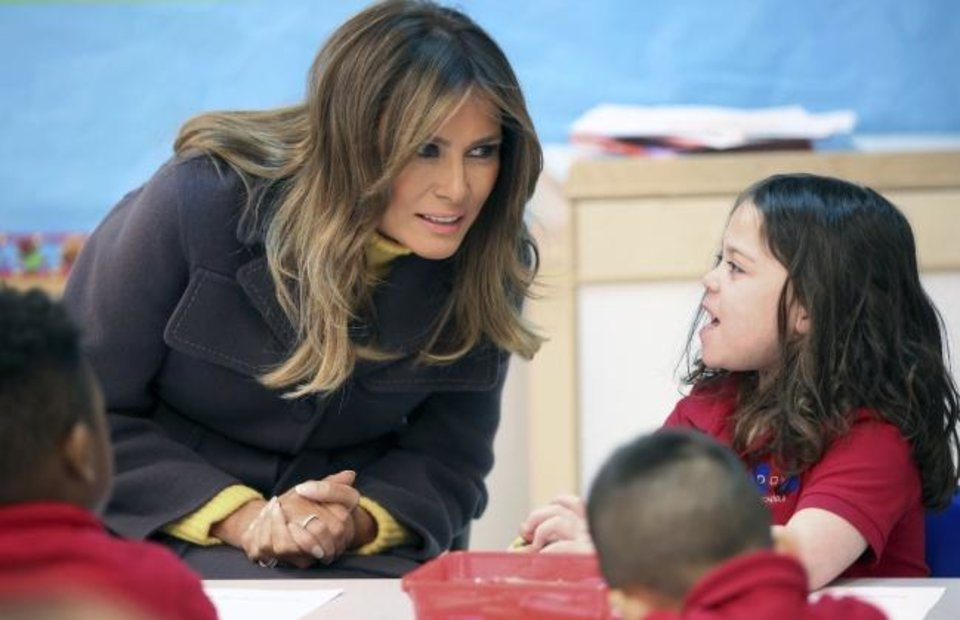 Photo -  First lady Melania Trump talks Monday with Precious Smith, a pre-K student, at  Dove School of Discovery in Tulsa.  [John Clanton/Tulsa World]