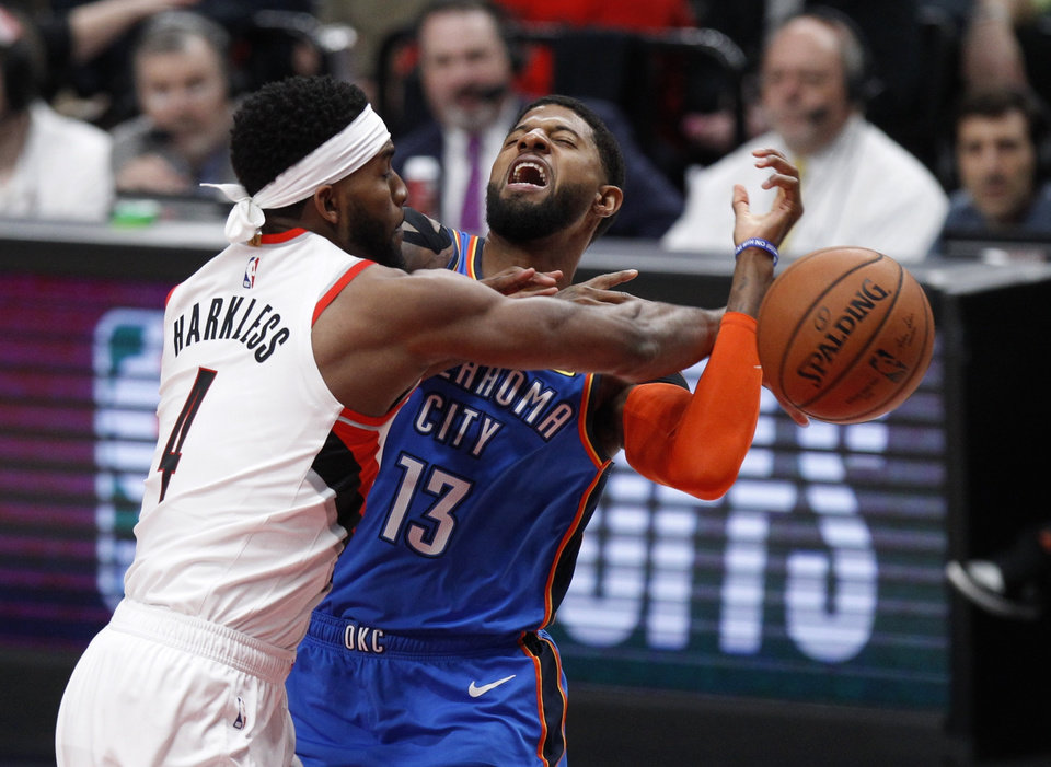 Photo - Portland Trail Blazers forward Maurice Harkless, left, knocks the ball away from Oklahoma City Thunder forward Paul George, right, during the first half of Game 1 of a first-round NBA basketball playoff series in Portland, Ore., Sunday, April 14, 2019. (AP Photo/Steve Dipaola)