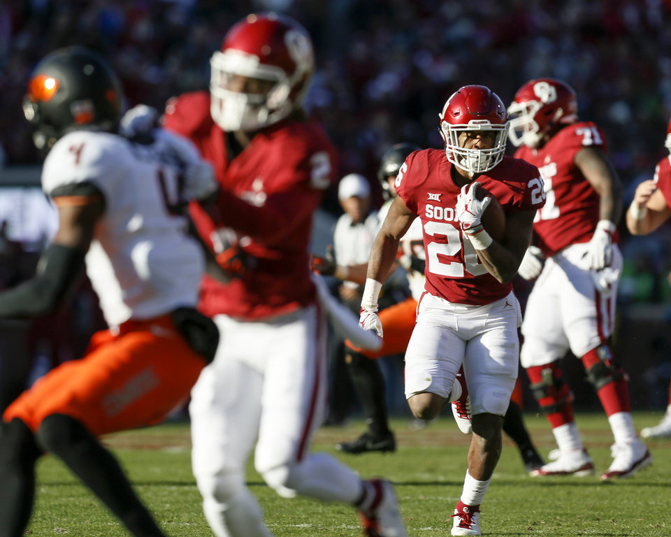 Photo - Oklahoma's Kennedy Brooks (26) runs for a touchdown in the second quarter during a Bedlam college football game between the University of Oklahoma Sooners (OU) and the Oklahoma State University Cowboys (OSU) at Gaylord Family-Oklahoma Memorial Stadium in Norman, Okla., Nov. 10, 2018. Photo by Nate Billings, The Oklahoman