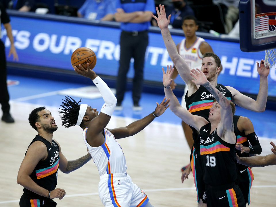 Photo - Oklahoma City's Luguentz Dort (5) goes to the basket in the fourth quarter of the NBA basketball game between the Oklahoma City Thunder and the San San Antonio Spurs at the Chesapeake Energy Arena, Wednesday, Feb. 24, 2021. [Sarah Phipps/The Oklahoman]