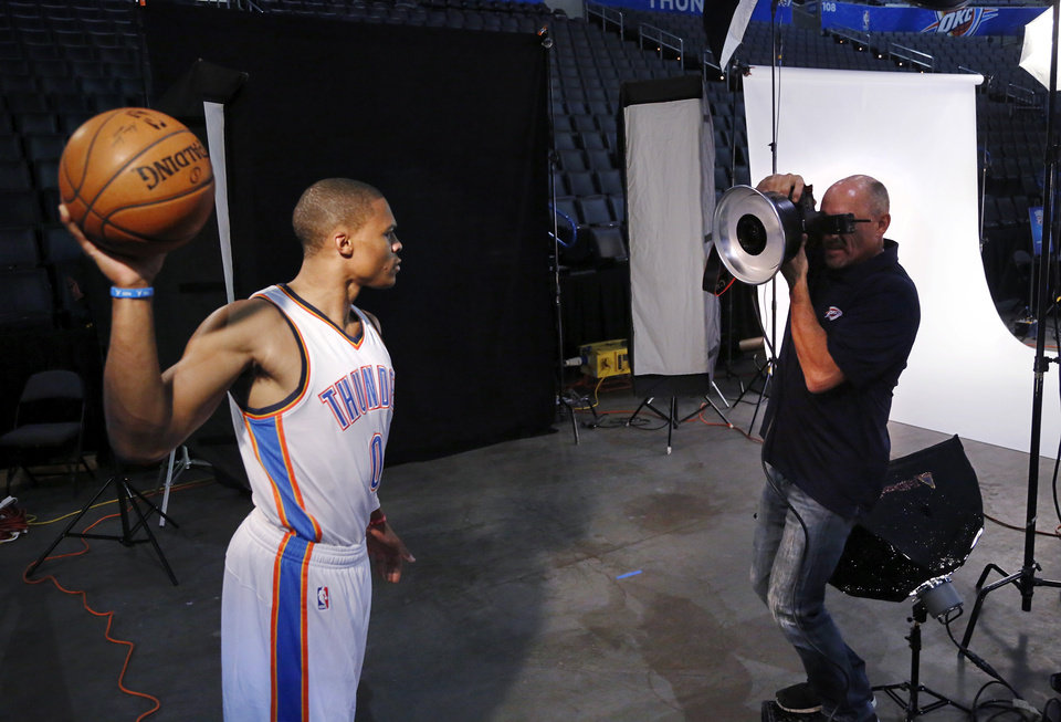Photo - Thunder guard Russell Westbrook strikes a pose for a photographer during OKC Thunder Media Day at Chesapeake Arena on Monday, Sep. 29, 2014.  Photo by Jim Beckel, The Oklahoman