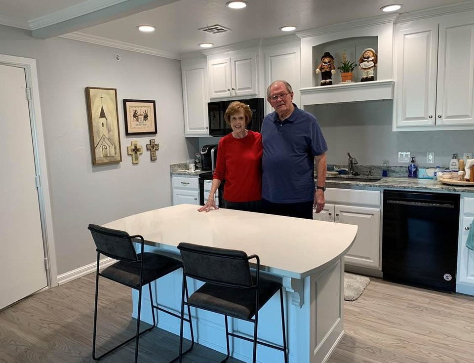 Photo - Linda and Mike Bauman enjoy their kitchen in their new apartment at Spanish Cove Retirement Village. [PHOTO PROVIDED]