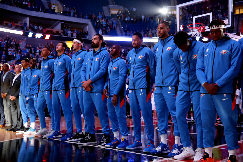Photo - The Thunder stand for introductions during the preseason NBA game between the Oklahoma City Thunder and the Dallas Mavericks at the BOK Center in Tulsa, Okla. , Tuesday, Oct. 8, 2019. [Sarah Phipps/The Oklahoman]