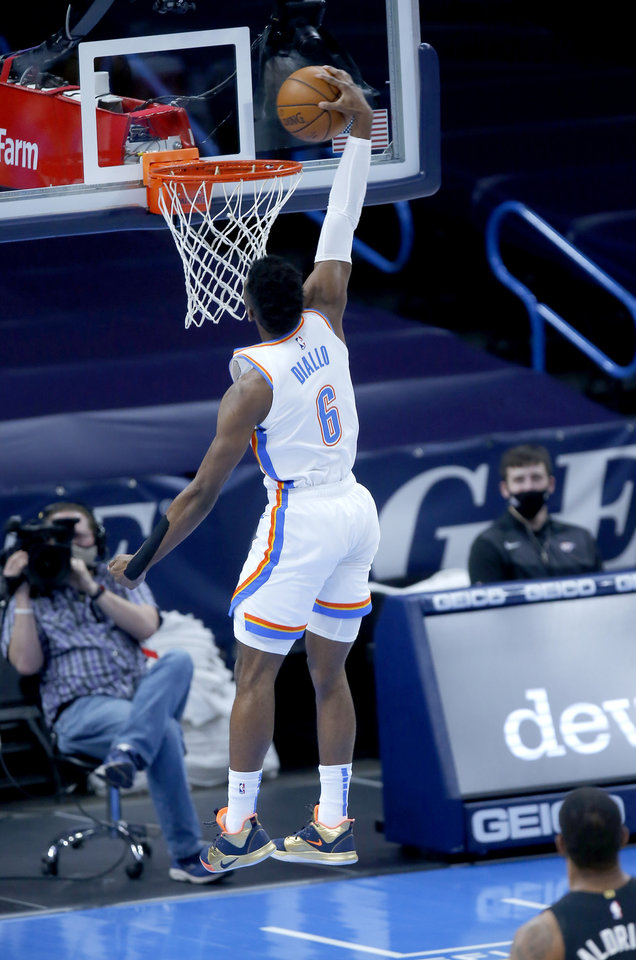 Photo - Oklahoma City's Hamidou Diallo (6) goes up for a dunk during the NBA basketball game between the Oklahoma City Thunder and the San San Antonio Spurs at the Chesapeake Energy Arena, Wednesday, Feb. 24, 2021. [Sarah Phipps/The Oklahoman]