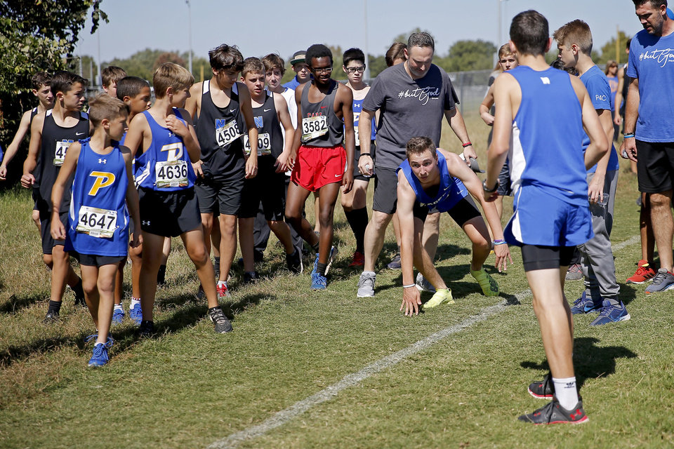 Photo - Newcastle runner Caleb Freeman, who was injured in a 2017 car crash, gets up after falling while running a cross country race at Carl Albert in Midwest City, Okla., Tuesday, Oct. 8, 2019. This was Caleb Freeman's first cross country race since getting injured in a 2017 car wreck. [Bryan Terry/The Oklahoman]