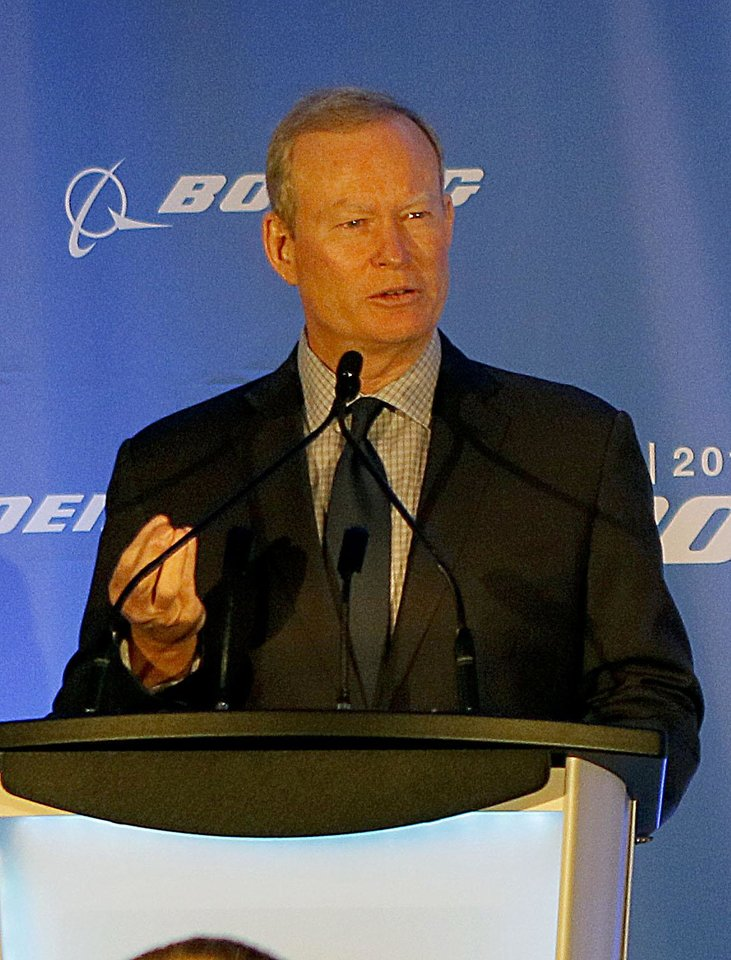 Photo - Mayor Mick Cornett speaks during a ground breaking ceremony for a new research facility at Boeing in Oklahoma City on Wednesday, July 29, 2015.  Photo by Jackie Dobson, The Oklahoman.