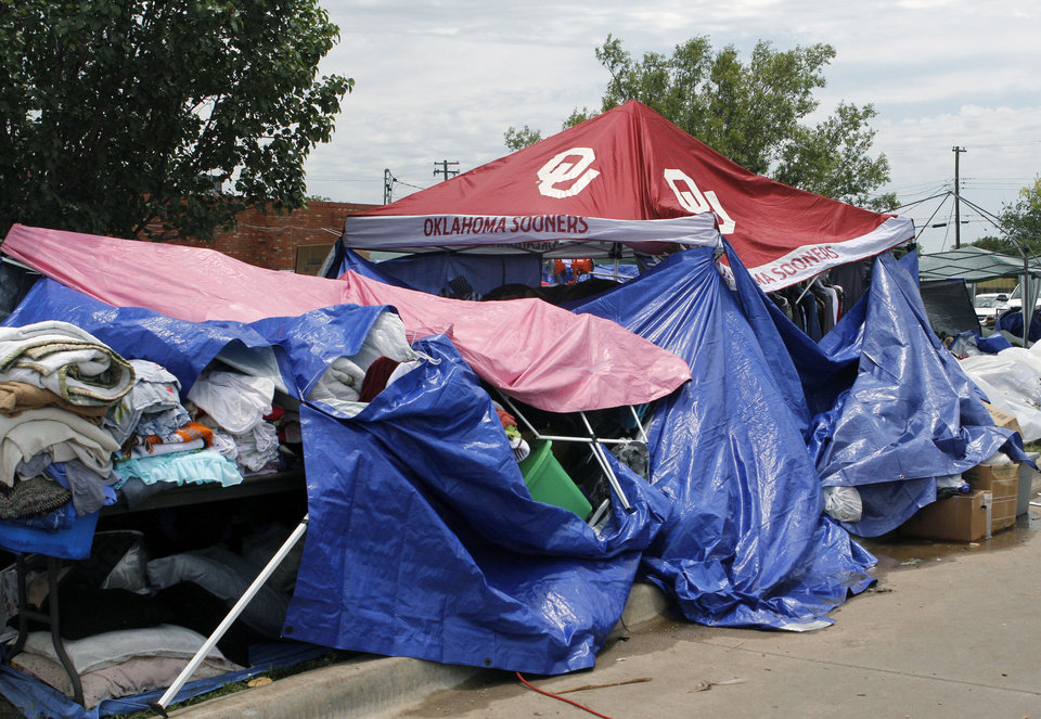 Photo - Donations are stacked up under tarps on the north perimeter of the tornado devastated part of Moore, OK, Thursday, May 23, 2013,  Photo by Paul Hellstern, The Oklahoman