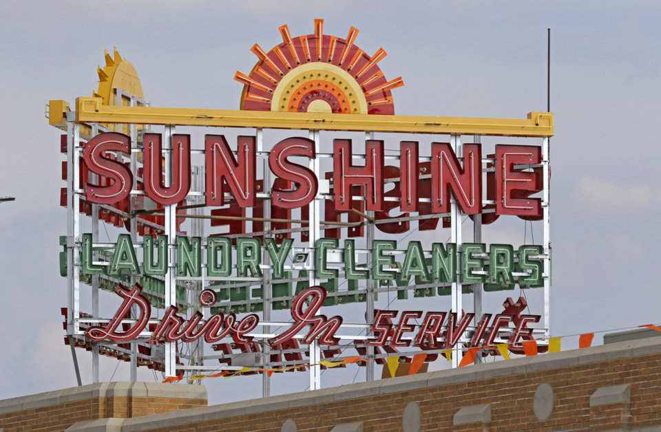 Photo -  The Sunshine Laundry Building's sign lights up now that the building has been converted into a brewery. [Photo by Steve Gooch, The Oklahoman Archives]
