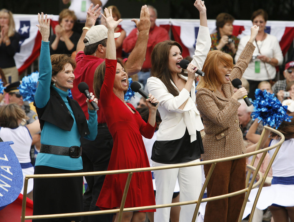 Photo - Former Miss Americas from Oklahom Jane Jayroe Gamble, Susan Powell, Jennifer Berry Gooden, and Shawntel Smith Wuerch sing in the opening of the Oklahoma Centennial Parade on Sunday, Oct. 14, 2007, in Oklahoma City, Okla.  By STEVE SISNEY, The Oklahoman