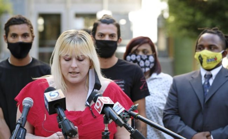 Photo -  Mia Hogsett speaks outside the Oklahoma County courthouse Monday after pleading guilty to two reduced charges arising from incidents in June outside Oklahoma City police headquarters. [DOUG HOKE/THE OKLAHOMAN]