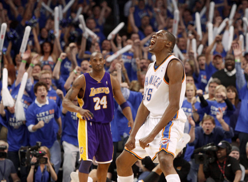 Photo - Oklahoma City's Kevin Durant reacts in front of L.A.'s Kobe Bryant during the NBA basketball game between the Los Angeles Lakers and the Oklahoma City Thunder in game six of the first round series at the Ford Center in Oklahoma City, Friday, April 30, 2010. Photo by Bryan Terry, The Oklahoman
