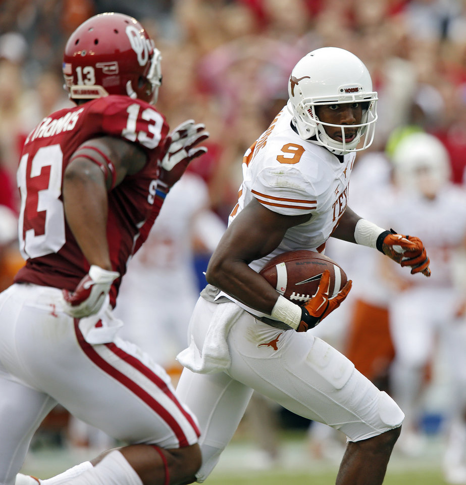 Photo - Texas' John Harris (9) runs past Oklahoma's Ahmad Thomas (13) for a touchdown during the college football game between the University of Oklahoma Sooners (OU) and the University of Texas Longhorns (UT) during the Red River Showdown at the Cotton bowl in Dallas, Texas on Saturday, Oct. 11, 2014. Photo by Chris Landsberger, The Oklahoman