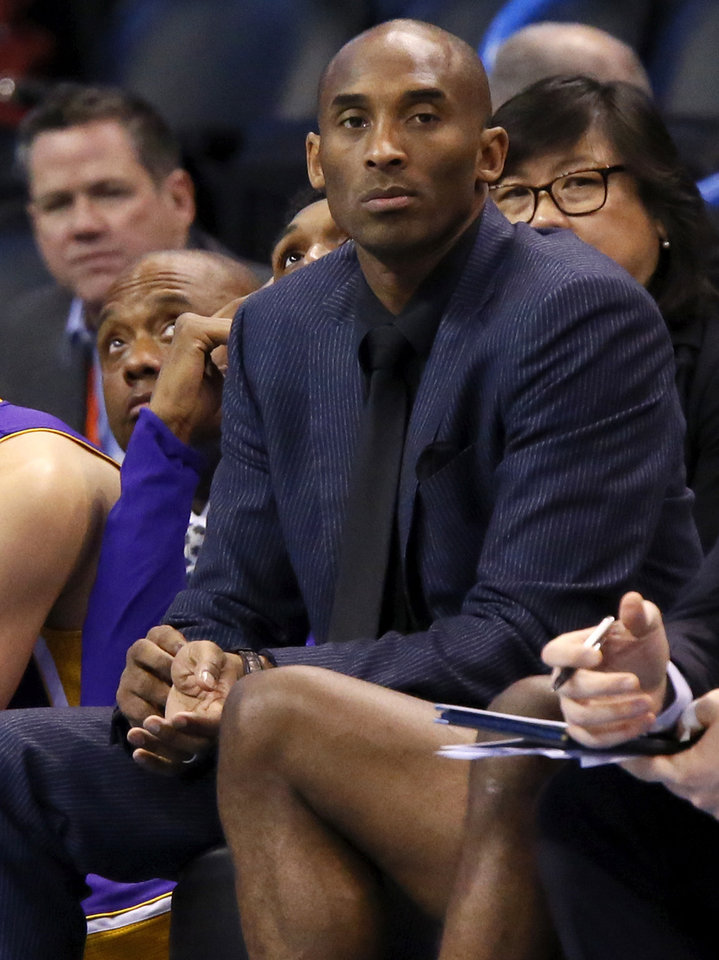 Photo - Los Angeles' Kobe Bryant (24) sits on the bench during an NBA basketball game between the Oklahoma City Thunder and the Los Angeles Lakers at Chesapeake Energy Arena in Oklahoma City, Saturday, Dec. 19, 2015. Oklahoma City won 118-78. Bryant did not play because of a sore right shoulder. Photo by Nate Billings, The Oklahoman