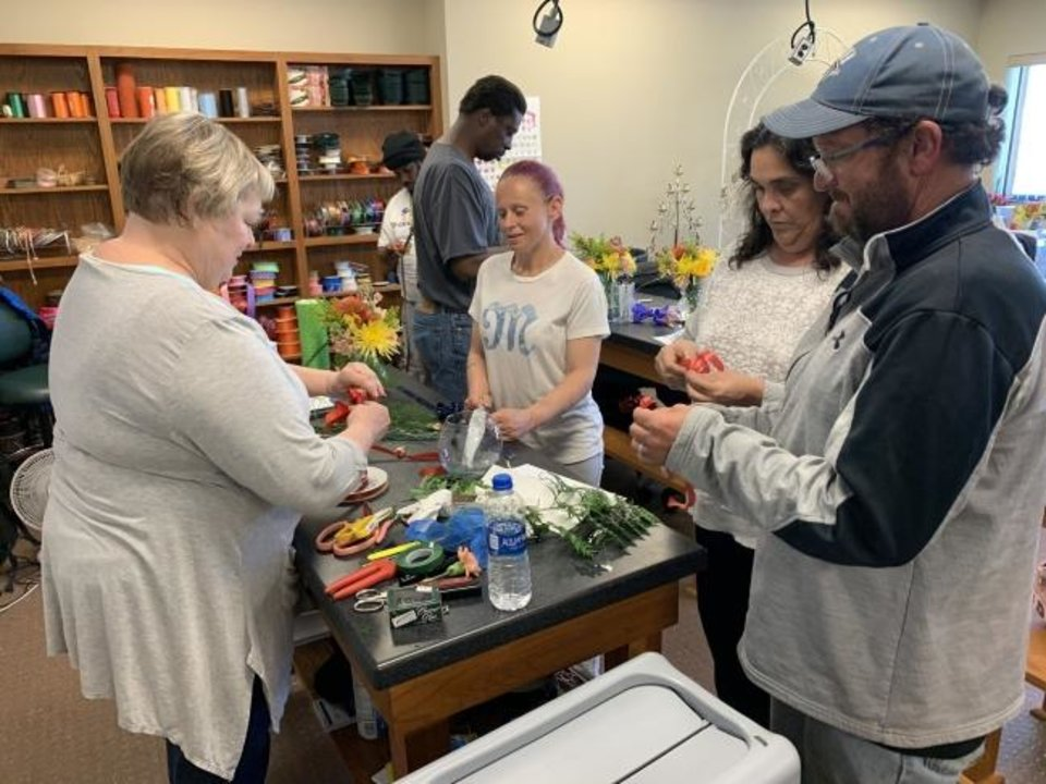 Photo -  This March photo shows students at Oklahoma State University-Oklahoma Cityduring a floral design class. The school partnered with the Curbside Chronicle to provide a certificate to selected vendors, but the in-person class has been canceled due to the coronavirus. [OSU-OKC PHOTO]