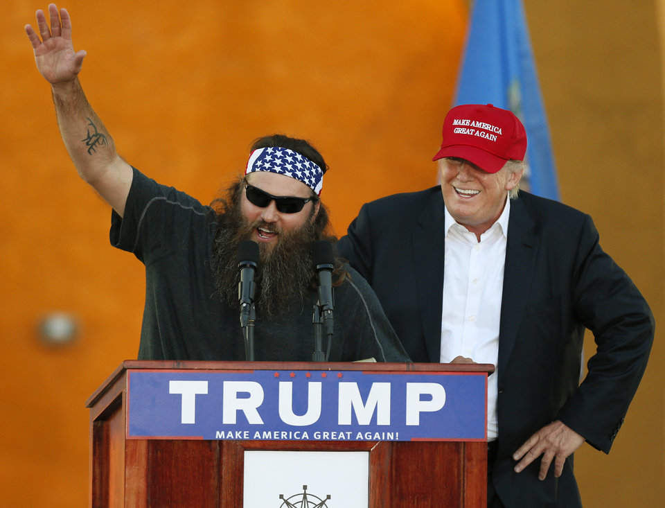"Photo - Willie Robertson, left, from the television show ""Duck Dynasty"" speaks in support of Republican presidential candidate Donald Trump during the Oklahoma State Fair at State Fair Park in Oklahoma City, Friday, Sept. 25, 2015. Photo by Nate Billings, The Oklahoman"