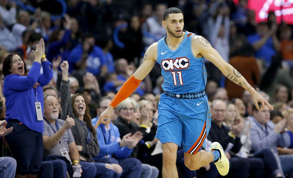 Photo - Oklahoma City's Abdel Nader (11) celebrates a 3-point basket during the NBA game between the Oklahoma City Thunder and the Orlando Magic at the Chesapeake Energy Arena  Tuesday, Feb. 5, 2019. Photo by Sarah Phipps, The Oklahoman