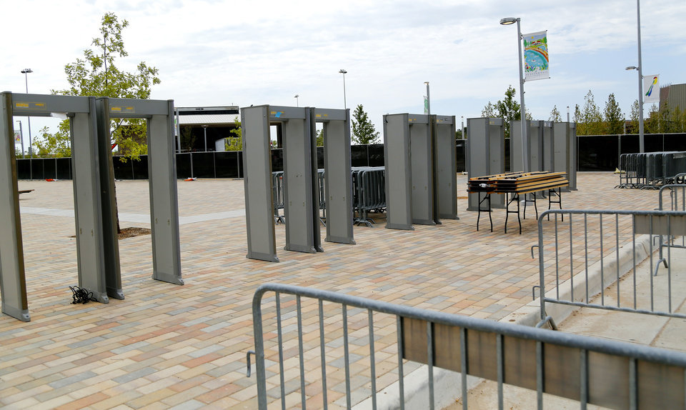 Photo - Metal detectors set up with barricades. Preparations are wrapping up for the opening night Kings of Leon concert to kick off the grand opening weekend of Scissortail Park Thursday, September 26, 2019. [Doug Hoke/The Oklahoman]