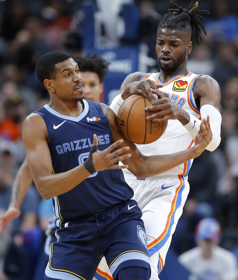 Photo - Oklahoma City's Nerlens Noel (9) fights for for the ball with Memphis' De'Anthony Melton (0) during an NBA basketball game between the Oklahoma City Thunder and the Memphis Grizzlies at Chesapeake Energy Arena in Oklahoma City, Wednesday, Dec. 18, 2019. [Bryan Terry/The Oklahoman]