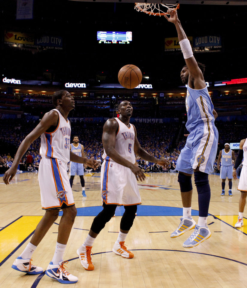 ad5c0e3394d Denver s Nene (31) dunks the ball beside Oklahoma City s Kendrick Perkins (5)  and Kevin Durant (35) during the NBA basketball game between the Denver ...