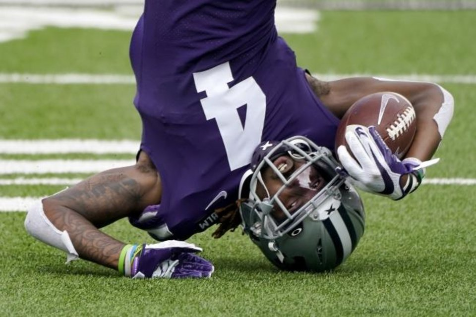 Photo -  It was an upside-down kind of day for Kansas State and receiver Malik Knowles in a 35-31 loss to Arkansas State on Saturday. [AP Photo/Charlie Riedel]