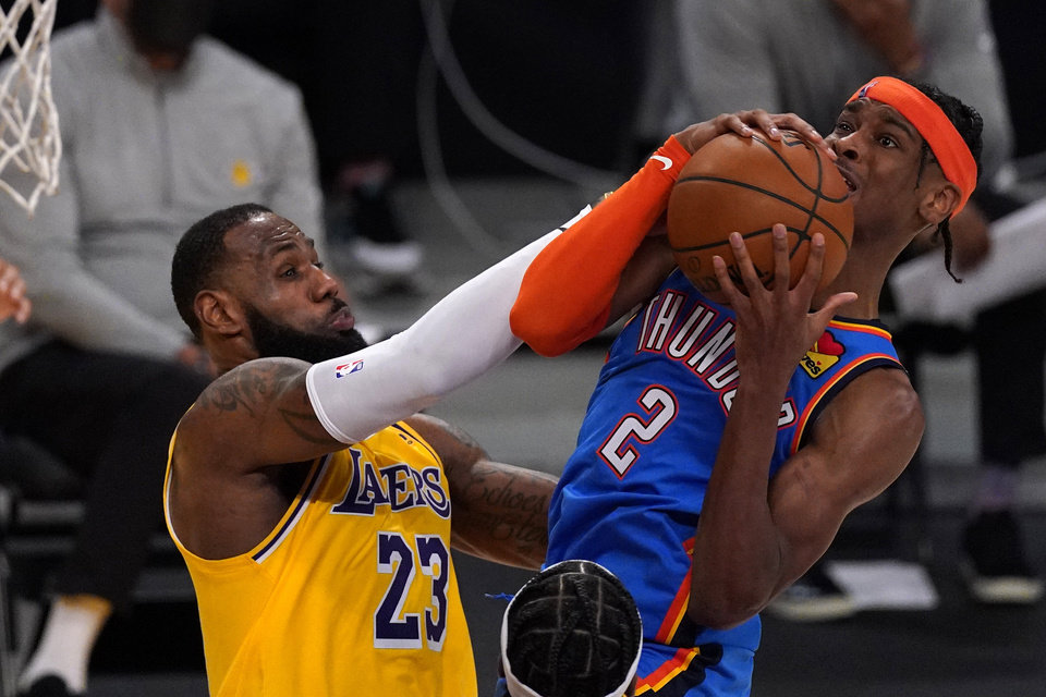 Photo - Oklahoma City Thunder guard Shai Gilgeous-Alexander, right, has his shot blocked by Los Angeles Lakers forward LeBron James during the second half of an NBA basketball game Monday, Feb. 8, 2021, in Los Angeles. The Lakers won 119-112 in overtime. (AP Photo/Mark J. Terrill)