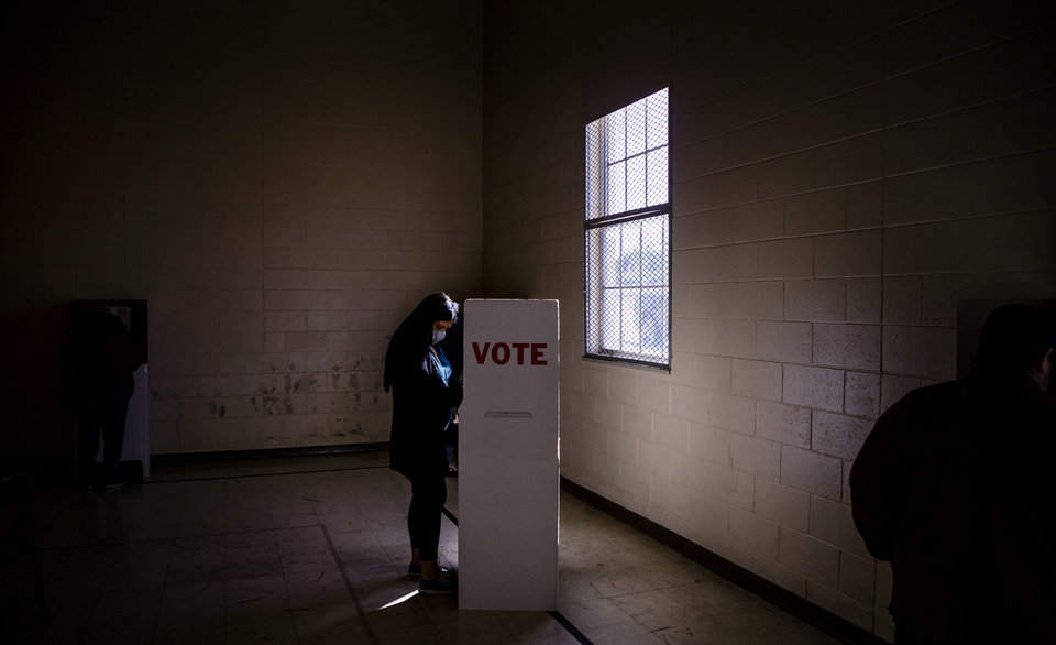Photo - A voter fills out her ballot at the Mayridge Baptist Church in Oklahoma City, Okla. on Tuesday, Nov. 3, 2020. [Chris Landsberger/The Oklahoman]