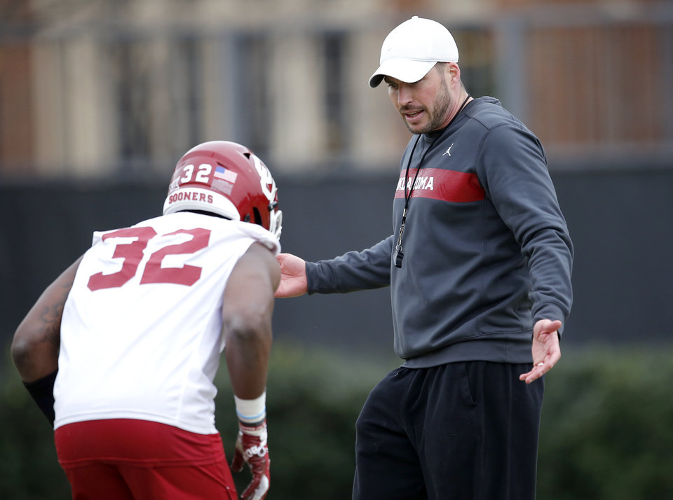 Photo - OU defensive coordinator Alex Grinch talks with OU's Delarrin Turner-Yell during defensive drills during a University of Oklahoma spring football practice in Norman, Okla., Thursday, March 7, 2019. Photo by Sarah Phipps, The Oklahoman