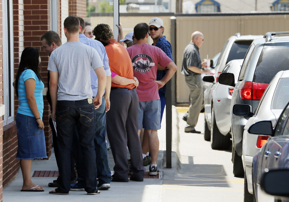 Photo - People wait in line to enter the Chick-fil-A at 6201 N May during Chick-fil-A Appreciation Day in Oklahoma City, Wednesday, Aug. 1, 2012. Photo by Nate Billings, The Oklahoman