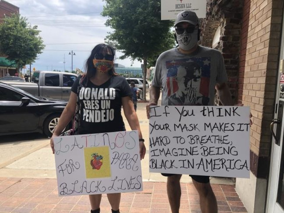 Photo -  George and Veronica James, of Moore, said they came to the Greenwood District Saturday to show solidarity with Black Tulsans. [Kayla Branch/The Oklahoman]