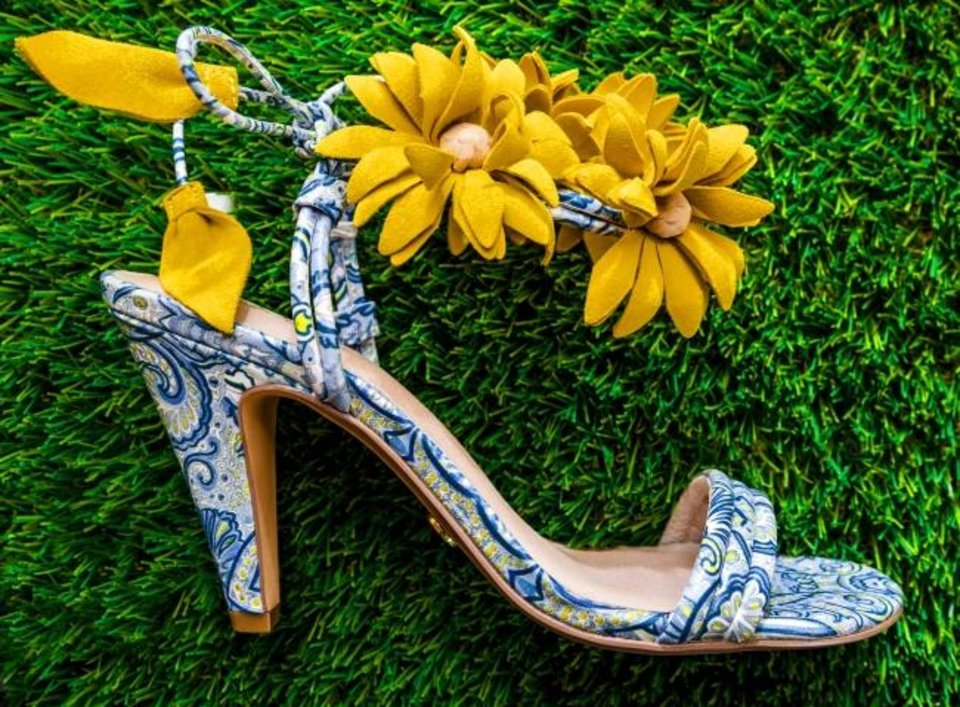 Photo -  Cecelia New York print heel with yellow floral bouquet ankle tie, $255, from Betsy King A Shoe Boutique.   [Chris Landsberger/The Oklahoman]