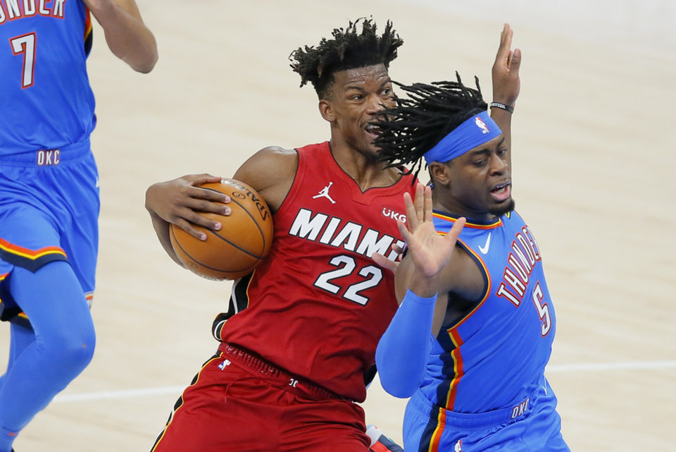 Photo - Miami's Jimmy Butler (22) tries to get past Oklahoma City's Luguentz Dort (5) during an NBA basketball game between the Oklahoma City Thunder and the Miami Heat at Chesapeake Energy Arena in Oklahoma City, Monday, Feb. 22, 2021. Miami won 108-94. [Bryan Terry/The Oklahoman]